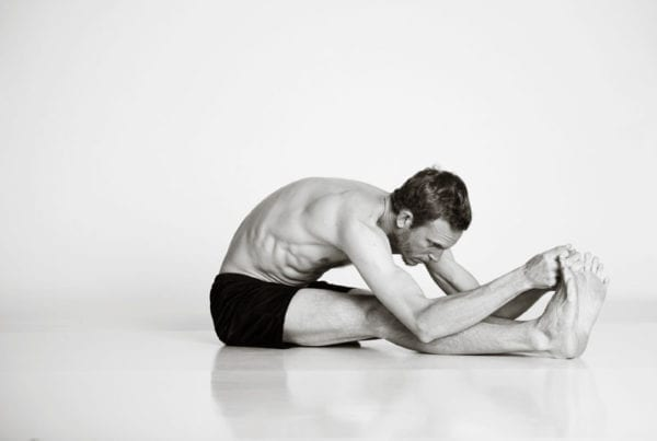 bikram hot yoga Asheville stretching pose man