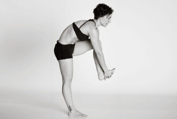 bikram hot yoga Asheville standing head to knee