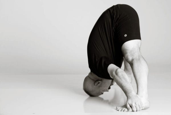bikram hot yoga Asheville standing separate leg man