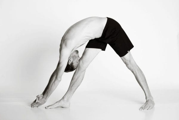 bikram hot yoga Asheville separate leg head to knee man
